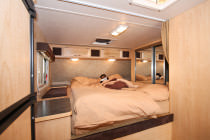 Bett im Truck Camper Slide-out
